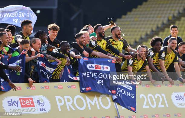 Players of Watford celebrate at the final whistle as they are Promoted to the Premier League following the Sky Bet Championship match between Watford...
