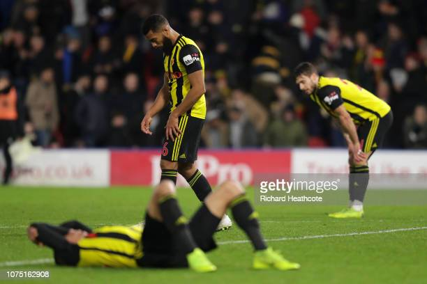 Players of Watford look dejected following their sides defeat in the Premier League match between Watford FC and Chelsea FC at Vicarage Road on...