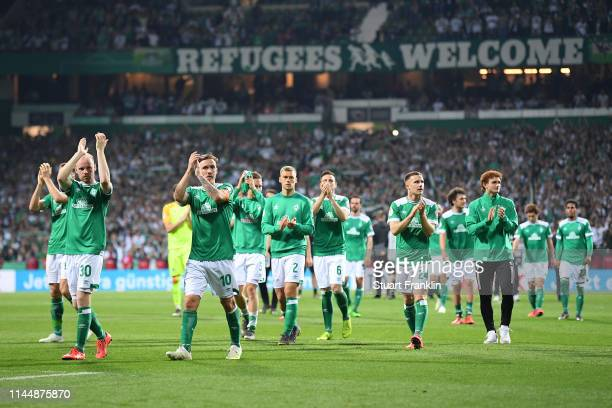 Players of Werder Bremen react after the DFB Cup semi final match between Werder Bremen and FC Bayern Muenchen at Weserstadion on April 24 2019 in...