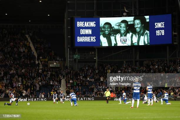 Players of West Bromwich Albion and Queens Park Rangers take the knee in support of Black Lives Matter under the giant LED screens showing the famed...
