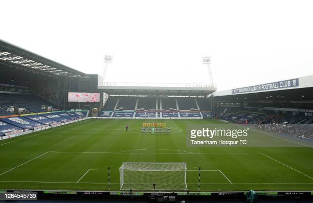Players of West Bromwich Albion and Tottenham Hotspur stand for a minutes silence in respect of Remembrance Sunday during the Premier League match...