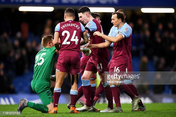 Players of West Ham celebrate with goalkeeper David Martin of West Ham United following victory in the Premier League match between Chelsea FC and...