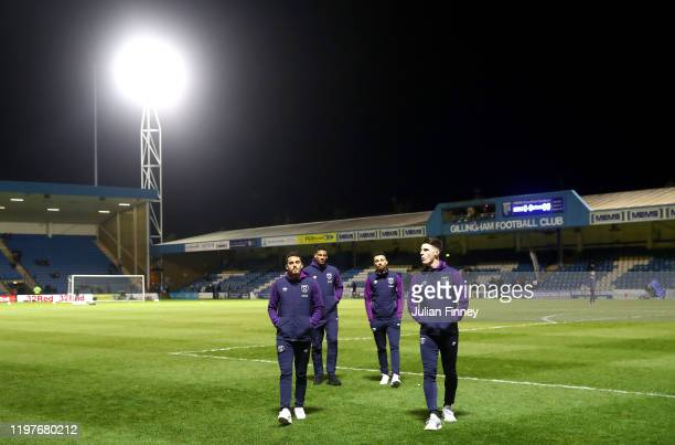 Players of West Ham look on during a pitch inspection prior to the FA Cup Third Round match between Gillingham and West Ham United at MEMS...