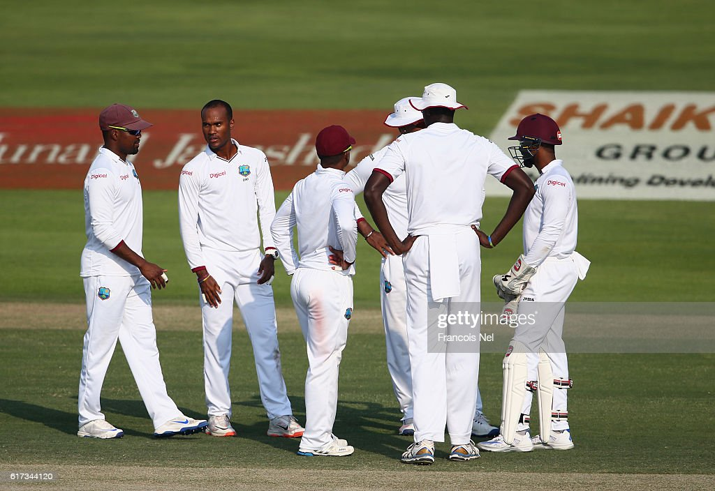 Players of West Indies waits for a pending decision during
