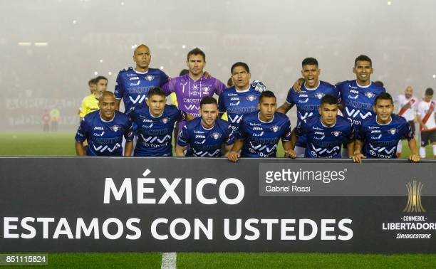 Players of Wilstermann pose for a photo prior to the second leg match between River Plate and Wilstermann as part of the quarter finals of Copa...