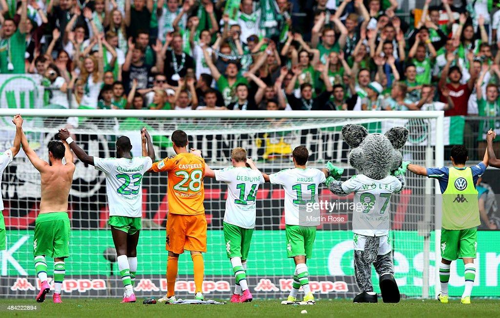 Players of Wolfsburg celebrate after winning the Bundesliga match between VfL Wolfsburg and Eintracht Frankfurt at Volkswagen Arena on August 16, 2015 in Wolfsburg, Germany.