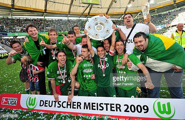 Players of Wolfsburg celebrate the German championship with the trophy after their Bundesliga match against SV Werder Bremen on May 23 2009 in...