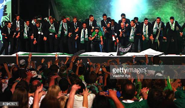 Players of Wolfsburg celebrate with the fans during the public welcome ceremony in the city of Wolfsburg to celebrate winning of the German...