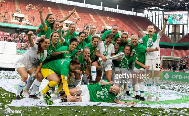 Players of Wolfsburg celebrate with the trophy after winning the Women's DFB Cup final match between VfL Wolfsburg and SC Freiburg at...