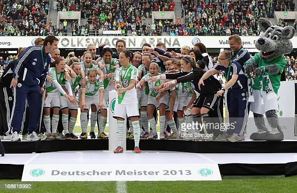 Players of Wolfsburg celebrate with the trophy on the podium after winning the german championship after the Women's Bundesliga match between VfL...