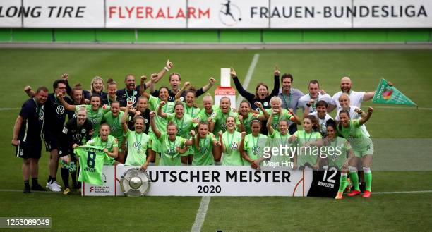 Players of Wolfsburg celebrate with the trophy to celebrate the championship following the Flyeralarm Frauen Bundesliga match between VfL Wolfsburg...