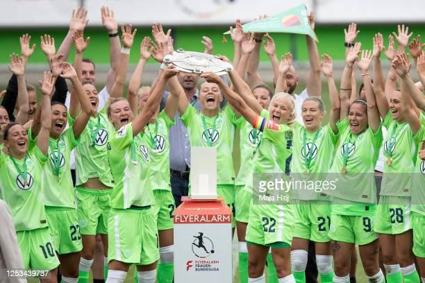 Players of Wolfsburg celebrate with trophy after wining championship following the Flyeralarm Frauen Bundesliga match between VfL Wolfsburg Women's...