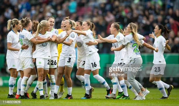 Players of Wolfsburg celebrates after winning the Women's DFB Cup final match between VfL Wolfsburg and SC Freiburg at RheinEnergieStadion on May 01...