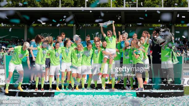 Players of Wolfsburg lift the Championship trophy in celebration of the German Championship title following the Allianz Women's Bundesliga match...