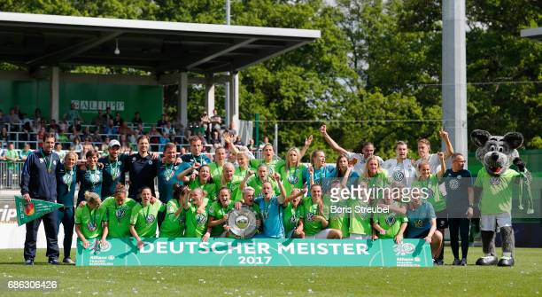 Players of Wolfsburg pose in celebration of the German Championship title following the Allianz Women's Bundesliga match between VfL Wolfsburg and FF...