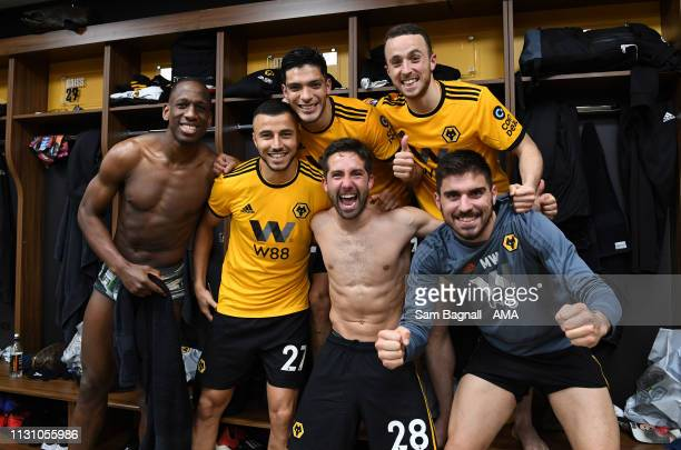 Players of Wolverhampton Wanderers celebrate in the changing room during the FA Cup Quarter Final match between Wolverhampton Wanderers and...