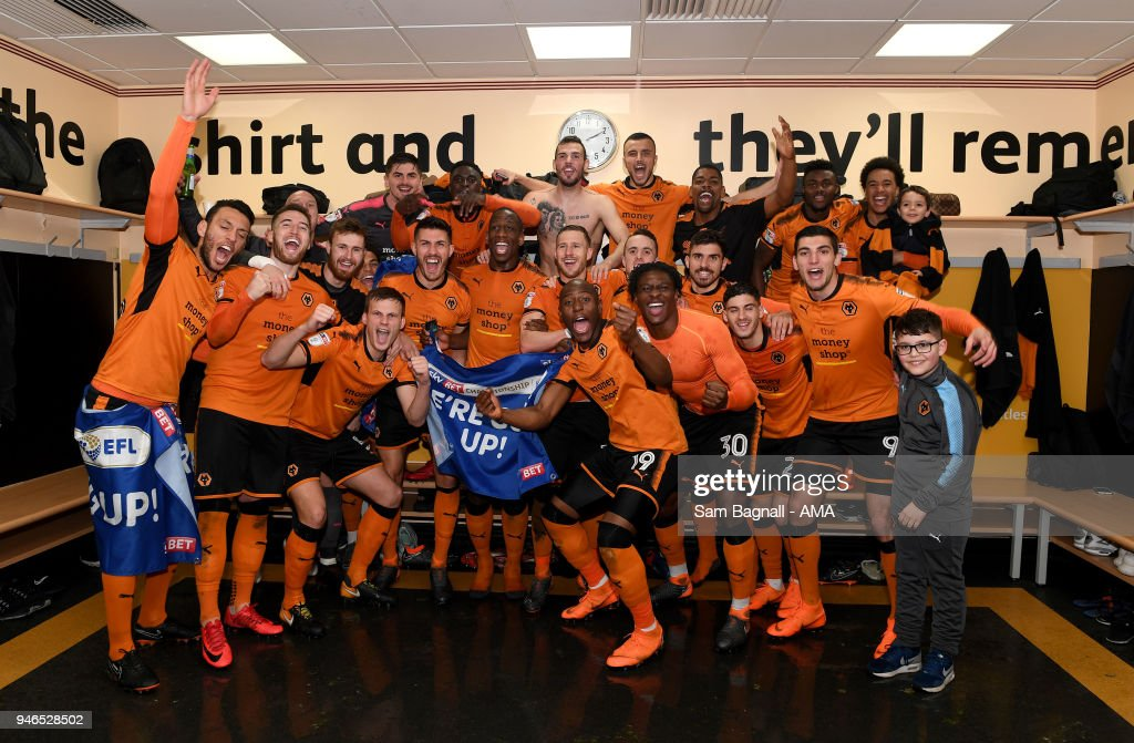 Players of Wolverhampton Wanderers celebrate promotion to the Premier League during the Sky Bet Championship match between Wolverhampton Wanderers and Birmingham City at Molineux on April 15, 2018 in Wolverhampton, England.