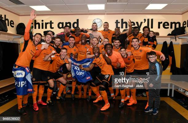 Players of Wolverhampton Wanderers celebrate promotion to the Premier League during the Sky Bet Championship match between Wolverhampton Wanderers...