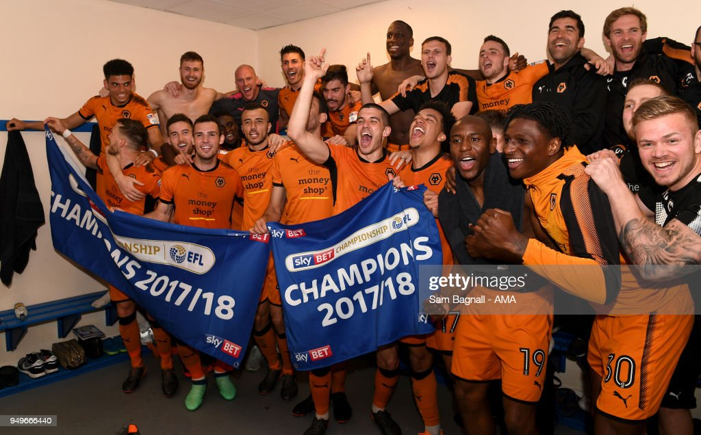 Players of Wolverhampton Wanderers celebrate winning the Championship during the Sky Bet Championship match between Bolton Wanderers and Wolverhampton Wanderers at Macron Stadium on April 21, 2018 in Bolton, England.