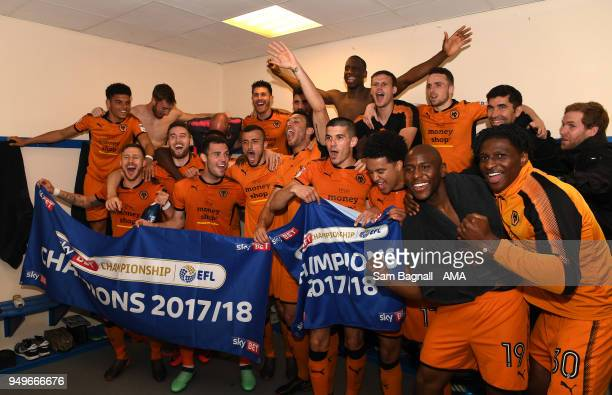 Players of Wolverhampton Wanderers celebrate winning the Championship during the Sky Bet Championship match between Bolton Wanderers and...