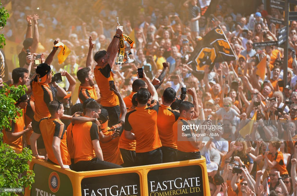 Players of Wolverhampton Wanderers during their celebrations of winning the Sky Bet Championship on a winners parade around the city of Wolverhampton on May 7, 2018 in Wolverhampton, England.