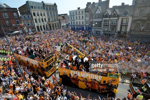 Players of Wolverhampton Wanderers during their celebrations of winning the Sky Bet Championship on a winners parade around the city of Wolverhampton...