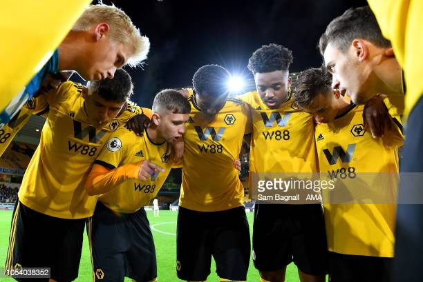 Players of Wolverhampton Wanderers huddle before kick off during the Premier League 2 match between Wolverhampton Wanders and Manchester United at...