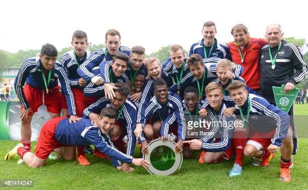 Players of Wuerttemberg celebrate after winning the DFB U16 Federal Cup at Sportschule Wedau on April 30 2014 in Duisburg Germany
