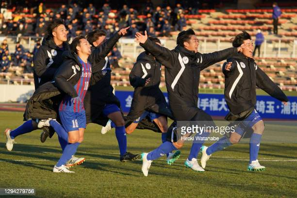 Players of Yamanashi Gakuin celebrate after the 99th All Japan High School Soccer Tournament third round match between Fujieda Meisei and Yamanashi...