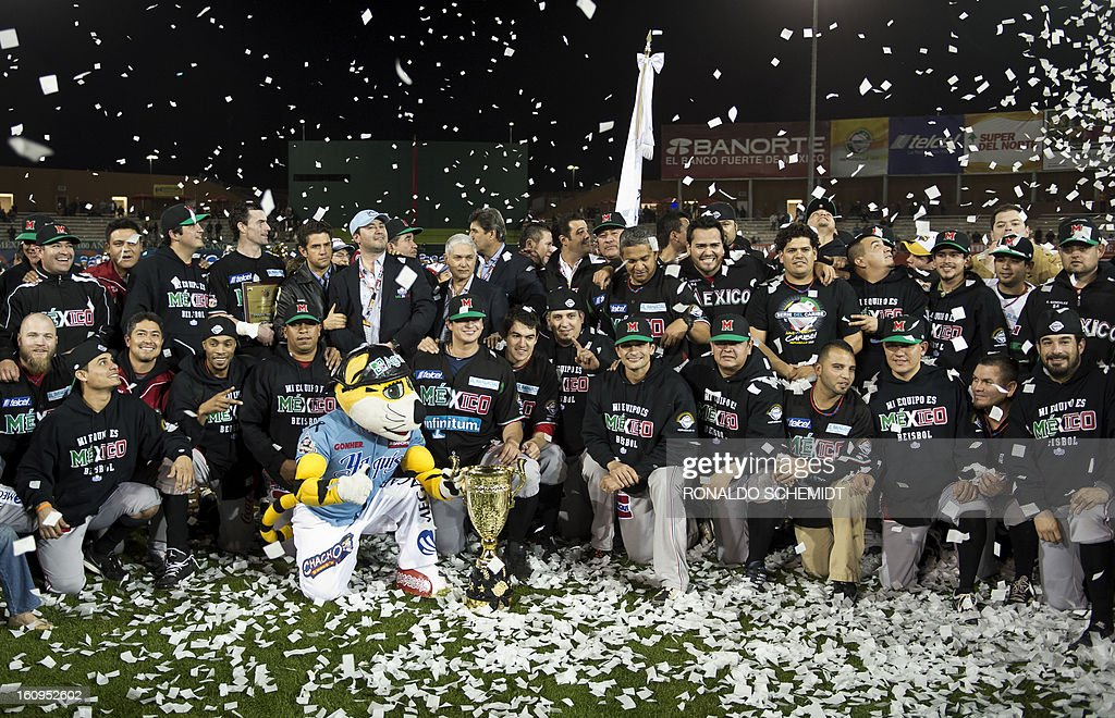 Players of Yaquis de Obregon of Mexico celebrate their victory over Leones del Escogido of the Dominican Republic, after final match of the 2013 Caribbean baseball series, on February 8, 2013, in Hermosillo, Sonora State, in northern of Mexico. Mexico won 4-3. AFP PHOTO/Ronaldo Schemidt