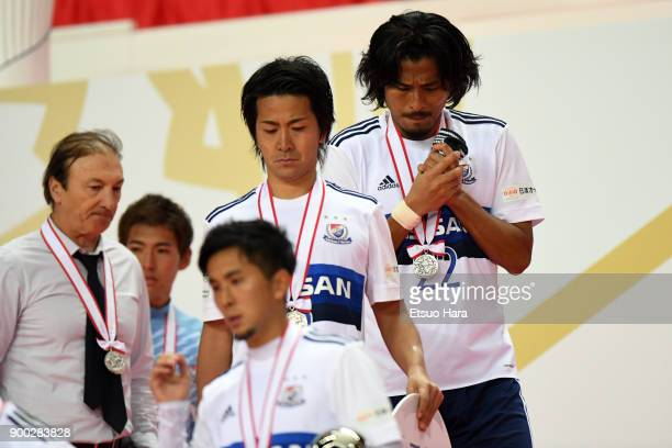Players of Yohohama FMarinos show dejection during the medal ceremony after the 97th All Japan Football Championship final between Cerezo Osaka and...