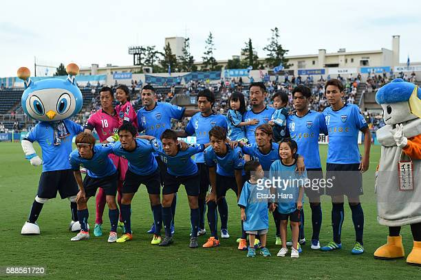 Players of Yokohama FC line up for team photos prior to the JLeague second division match between Yokohama FC and Consadole Sapporo at the Nippatsu...