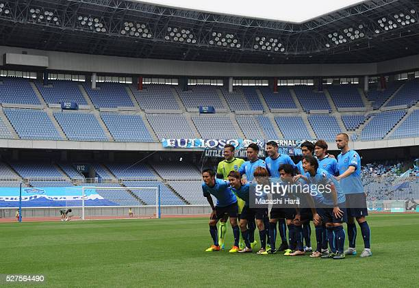 Players of Yokohama FC pose for photograph with many empty seats prior to the JLeague second division match between Yokohama FC and Fagiano Okayama...