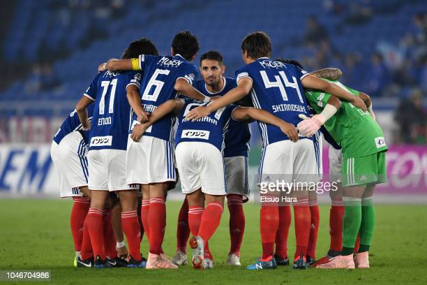 Players of Yokohama F.Marinos huddle during the J.League J1 match between Yokohama F.Marinos and Consadole Sapporo at Nissan Stadium on October 5,...