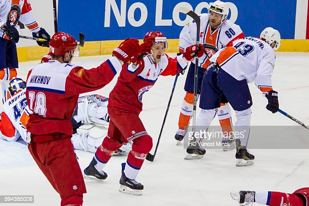 Players of YunostMinsk Andrei Mikhnov and Alexander Karakulko celebrate 1st score to goal Vaxjo Lakers during the game skate of the Champions Hockey...