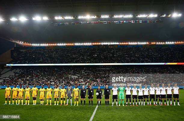 Players of Zimbabwe and Germany stand for the national anthems before the match between Zimbabwe and Germany for summer olympics at Arena Corinthians...