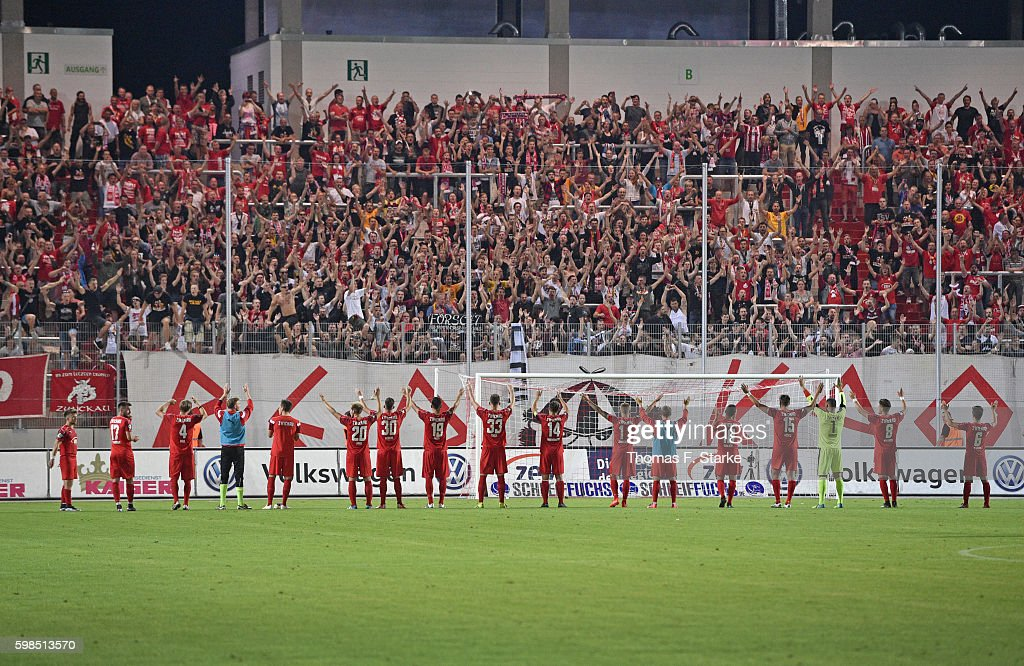 Players of Zwickau celebrate with their supporters after the Third League match between FSV Zwickau and 1. FC Magdeburg at Stadion Zwickau on September 1, 2016 in Zwickau, Germany.