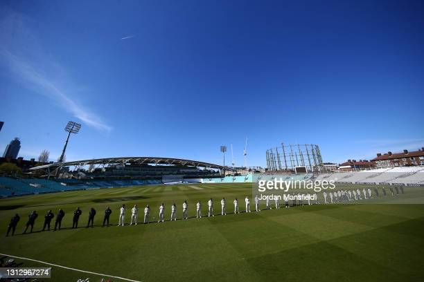 Players, officials and coaching staff observe a national minutes silence in memory of HRH Prince Philip, the Duke of Edinburgh during day three of...