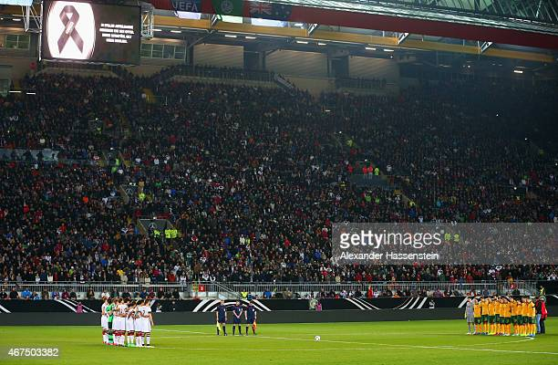 Players, officials and fans remember the victims of the recent Germanwings air crash prior to the international friendly match between Germany and...