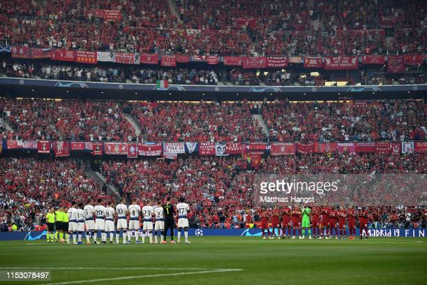 Players officials and fans take part in a minute of applause in memory of Jose Antonio Ryes prior to the UEFA Champions League Final between...