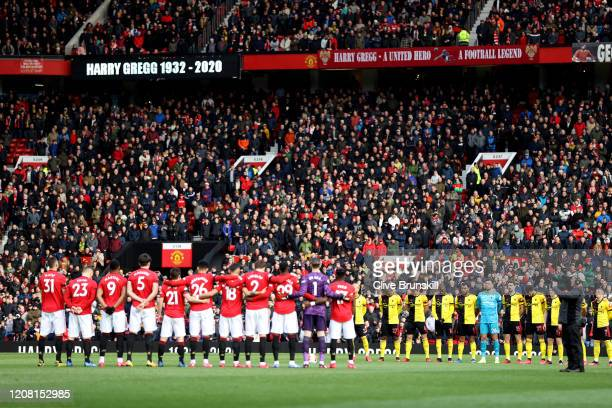 Players officials and fans take part in a minute of silence for former Manchester United player Harry Gregg prior to the Premier League match between...