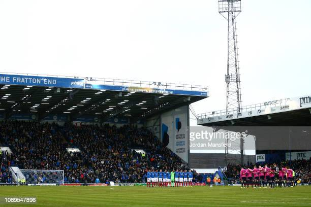 Players officials and fans take part in a minute of silence for Emiliano Sala prior to the FA Cup Fourth Round match between Portsmouth and Queens...