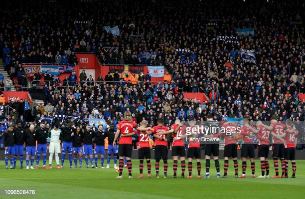Players officials and fans take part in a minute of silence in tribute to Emiliano Sala prior to the Premier League match between Southampton FC and...