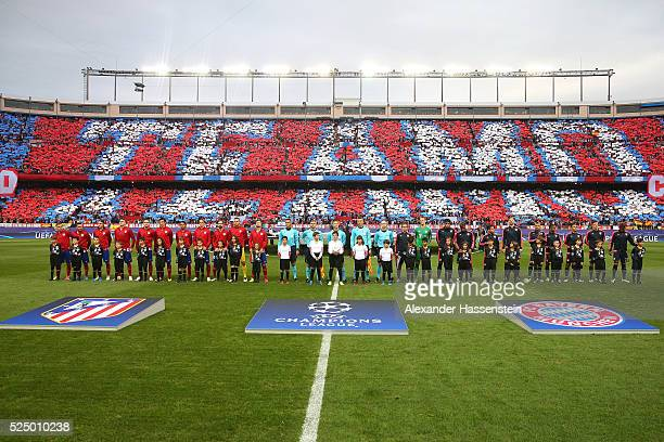 Players officials and mascots line up prior to the UEFA Champions League semi final first leg match between Club Atletico de Madrid and FC Bayern...