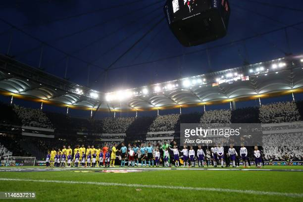Players officials and mascots line up prior to the UEFA Europa League Semi Final First Leg match between Eintracht Frankfurt and Chelsea at...