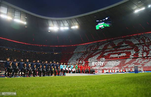 Players officials and mascots line up prior to UEFA Champions League semi final second leg match between FC Bayern Muenchen and Club Atletico de...