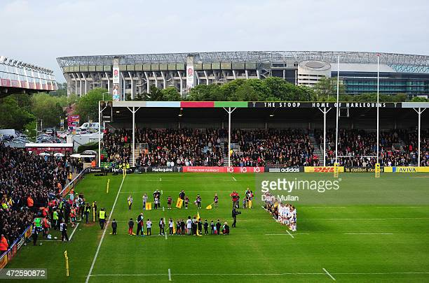 Players officials and spectators mark the 70th anniversary of VE Day prior to the Aviva Premiership match between Harlequins and Bath Rugby at...