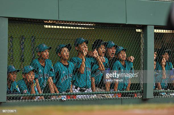 Players on Asia Pacific watch the game in late innings against the Caribbean in the international semifinal at Lamade Stadium on August 27 2009 in...