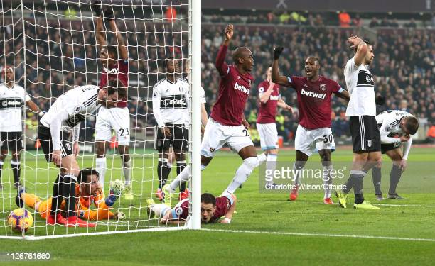 Players on both sides react as Javier Hernandez of West Ham scores their first goal during the Premier League match between West Ham United and...