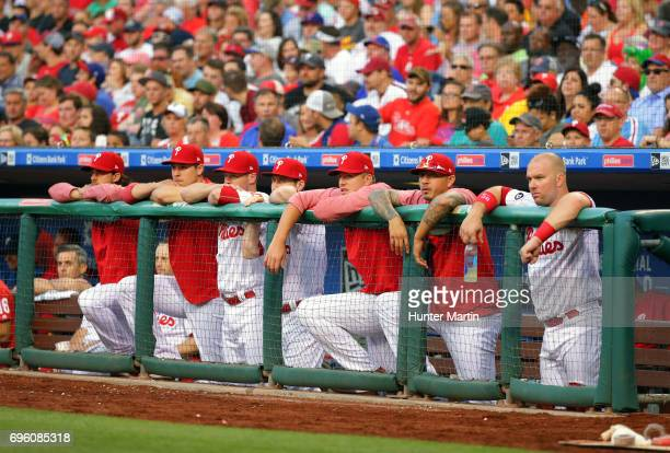 Players on the bench of the Philadelphia Phillies watch the action in the third inning during a game against the Boston Red Sox at Citizens Bank Park...